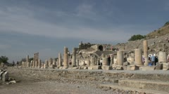 History & culture, Ephesus ruins, tourists columns wide shot Stock Footage