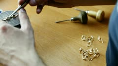 Stock Video Footage of handmade. making gold pendant.