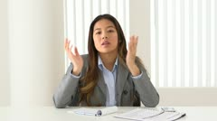 Asian businesswoman talking during video conference Stock Footage