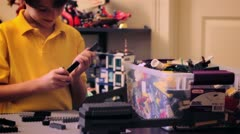 Young boy playing with Lego Set - stock footage