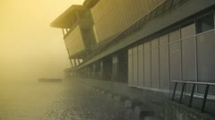 Monolithic Building Complex Disappearing Into Yellow Glowing Fog Stock Footage