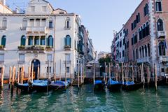 goldola boat parking in front of building in grand canal venice italy - stock photo
