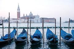 Goldola boat parking in lagoo of grand canal venice italy Stock Photos