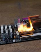 burning motherboard - stock photo