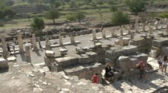 History & culture, Ephesus ruins, tourists theatre pan Stock Footage