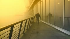 Approaching Man Outside Yellow Mist Soaked Building Stock Footage