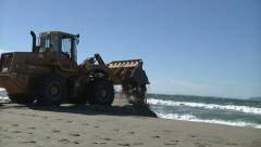 Wheel Loader Beach Coastal Erosion Storm Prevention Waves Wind Tide - stock footage