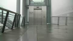 Exterior Misty Descending Elevator, Doors Closing And Opening - stock footage