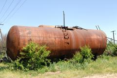 The old railway tank for transportation of mineral oil. Stock Photos
