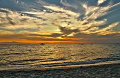 Stock Photo of sunset over sea
