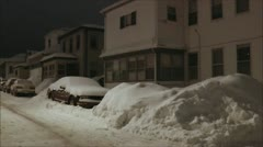 Snowbound street and cars - night time Stock Footage