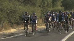 Cyclists In A Road Race Taking A Right Turn 2 Stock Footage