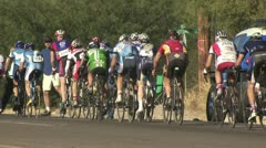 Rear View of Cyclists In A Road Race Stock Footage
