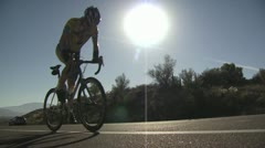 Cyclists In A Road Race As They Climb A Hill 5 - stock footage