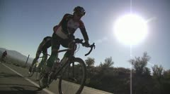 Racing Cyclists As They Come Downhill Stock Footage