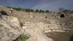 History & culture, Ephesus ruins, tourists theatre rack focus wide shot Stock Footage
