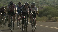 Cyclists In A Road Race Stock Footage