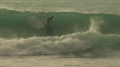 Surfer Riding A Large Wave 2 Stock Footage
