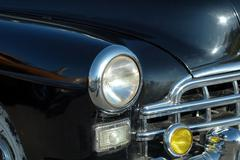 the left headlight of the old automobile - stock photo