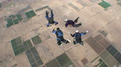 Four Skydivers Doing Aerial Acrobatics 2 Stock Footage