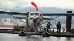 Seaplane Harbor Terminal Crewmen Turning Plane Stock Footage