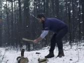 Lumberjack chopping wood in the winter, super slow motion, shot at 480fps NTSC Stock Footage