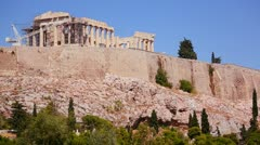 Stock Video Footage of The Acropolis and Parthenon on the hilltop in Athens, Greece.
