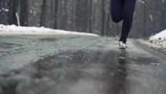 Stock Video Footage of Jogger running on wet road, super slow motion, shot at 240fps HD