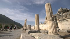 History & culture, Ephesus ruins, tourists road and columns wide shot Stock Footage