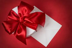 background with gift box and envelope - stock photo