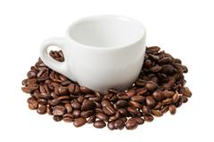 Espresso cup with coffee beans Stock Photos