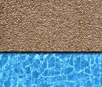 red sand stone pavement with pool background - stock photo