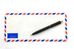 envelope with pen - stock photo