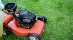 hand refill fill grass lawn mower cutter fuel tank - stock footage