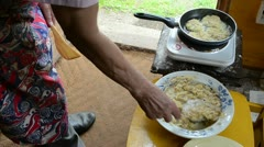Old woman bake cook potato pancake in rural house kitchen Stock Footage