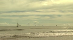 Wide shot of multiple sailboats distancing themselves from land 3 Stock Footage