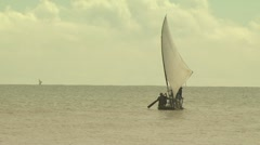 Wide establishing shot of one of the sailboats getting farther away from land Stock Footage