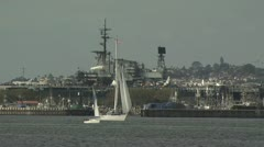 Boats Sailing in a Marina With the City in the Background Stock Footage