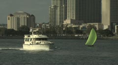 Boat Approaches The Marina; Cityscape in the Background Stock Footage