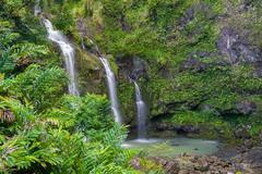 three waterfalls in a tropical forest - stock photo