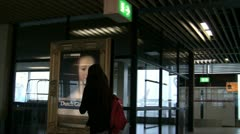 Two Strolling Girls In Amsterdam Airport Stock Footage