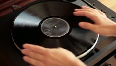 Putting vinyl disc on turntable, top view HD Stock Footage