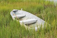 boat in the grass - stock photo