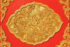 detail of golden ornamental art on chinese wooden door - stock photo