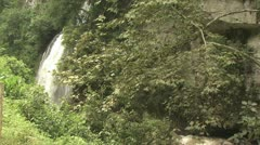 Tropical Waterfall Spilling Into A River Stock Footage