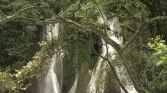 Two Beautiful Waterfalls Trees In The Foreground Stock Footage