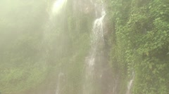Giant Tropical Waterfall And Surrounding Lush Vegetation Stock Footage
