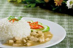 Chicken in gravy sauce rice Stock Photos