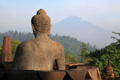 buddha statue at borobudur temple - stock photo