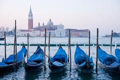 goldola boat parking in lagoo of grand canal venice italy - stock photo